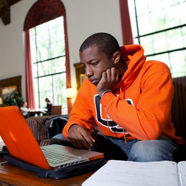 student studying a laptop in the memorial union